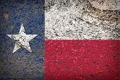 picture of texas flag  - Image of an old Texas flag on the rock texture - JPG
