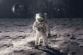 Astronaut On Rock Surface With Space Background. Elements Of This Image Furnished By Nasa poster