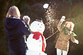 stock photo of snowball-fight  - Two girls having snowball fight - JPG