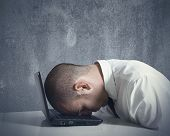 stock photo of sadness  - Concept of a stressed businessman at work - JPG