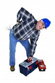 stock photo of spinal disks  - Workman with backache lifting the tool box - JPG