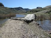 Old Rickety Wooden Bridge Over River in High Desert