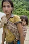 picture of hmong  - Portrait Hmong woman with baby at a street in the District Khanthao - JPG