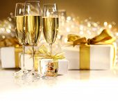 picture of champagne glass  - Glasses of champagne with gold ribbon gifts