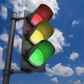 stock photo of traffic signal  - Traffic Light in a blue sky with all the lights on - JPG