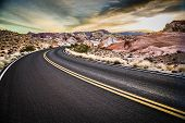 stock photo of valley fire  - Highway cuts through the desert landscape of the Valley of Fire State Park - JPG