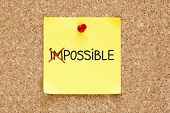 stock photo of marker pen  - The word Impossible turning into Possible on yellow sticky note - JPG