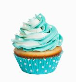 stock photo of icing  - Teal birthday cupcake with butter cream icing isolated on white - JPG