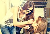 picture of face-powder  - Young beautiful fashion girl applying make - JPG