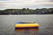 An inflatable raft in a lake
