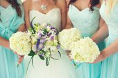 picture of purple white  - Close up of bride and bridesmaids bouquets - JPG