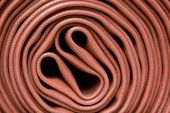 picture of firehose  - A Close up shot of a fire hose - JPG