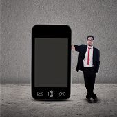 Businessman And Smartphone On Grey