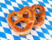 image of pretzels  - Two pretzel in heart shape on white blue background top view - JPG