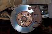 foto of calipers  - Car wheel brake rusty disc with pads rotor disc and caliper assembly - JPG