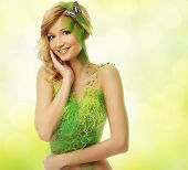 Beautiful young woman in conceptual spring costume with butterfly