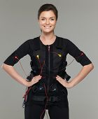 Young woman in Electro Muscular Stimulation EMS exercise training costume