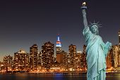 stock photo of statue liberty  - Midtown Manhattan Skyline and The Statue of Liberty at Night - JPG