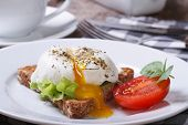stock photo of benediction  - sandwich with open poached egg and tomato on a plate and coffee horizontal macro - JPG