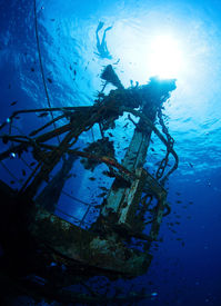 stock photo of bottomless  - Bottom view of the ship wreck and silhouette of the snorkeler on the surface - JPG