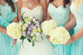 stock photo of marriage ceremony  - Close up of bride and bridesmaids bouquets - JPG