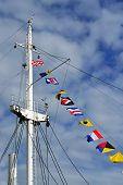 image of mast  - Mast of the ship and maritime signal flags - JPG