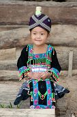 stock photo of hmong  - cute girl from Laos Hmong in traditional national costume of the ethnic group - JPG