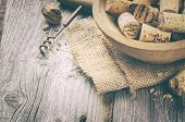 stock photo of wine cellar  - Wine corks and corkscrew on wooden table - JPG
