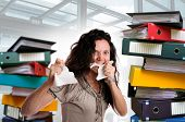 foto of insane  - Insane woman with stacks of files around isolated in white