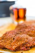 foto of barbie  - Large slab of meat seasoned ready to be cooked in smoker - JPG