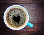 foto of latte coffee  - a cup of coffee with a heart shape - JPG