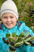 stock photo of aronia  - A boy with a sprig of Aronia - JPG
