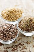 stock photo of flax seed  - Bowls of whole and ground flax seed or linseed - JPG