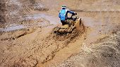 pic of overcoming obstacles  - Extreme driving ATV on overcoming mud obstacles - JPG