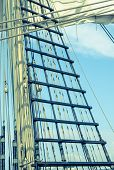 image of sailing vessel  - Sails and tackles of a sailing vessel on a background of the sky - JPG