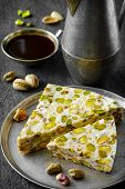 picture of phyllo dough  - eastern traditional dessert with nuts on gray background - JPG