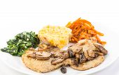stock photo of sauteed  - Butterfly Pork Loin smothered in sauteed mushrooms and served with wilted garlic - JPG