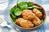 pic of meatball  - baked meatballs with pepper and spinach on a grey background - JPG