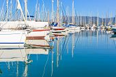 picture of sloop  - Panorama of a big Gouvia harbour with white yachts and boats on a beautiful sunny day over the island of Corfu - JPG