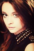 foto of stud  - Fashionable teenager girl wearing blouse with gold metal stud on black