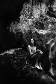 stock photo of grotto  - Young attractive girl posing in a grotto in the Vorontsov park - JPG