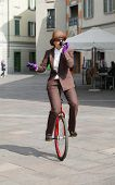 image of unicycle  - woman through the city with the unicycle to go to work - JPG
