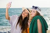image of memento  - Close up Pretty Young Women in Summer Outfits at the Beach Taking Selfie Photo on a Tropical Climate - JPG
