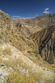 picture of arid  - Picturesque view arid landscape around Canon del Colca famous tourist destination in Peru - JPG