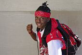 image of good-looker  - Young black man posing and smiling at the Canada Day festivities in Ottawa - JPG