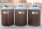 stock photo of waste management  - Trashcan that separate waste into three part contains wastepapers pet bottle and can bottles - JPG