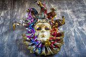 foto of venetian carnival  - Classical venetian carnival mask and serpentine on wood - JPG