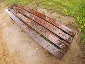 stock photo of distort  - Bench in the park just after a spring rain with wide angle distortion view - JPG