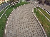 image of distort  - Ramp for physically challenged from the granite pavement with wide angle fisheye lens and distortion view - JPG