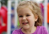 foto of little young child children girl toddler  - Portrait a little girl on playground - JPG